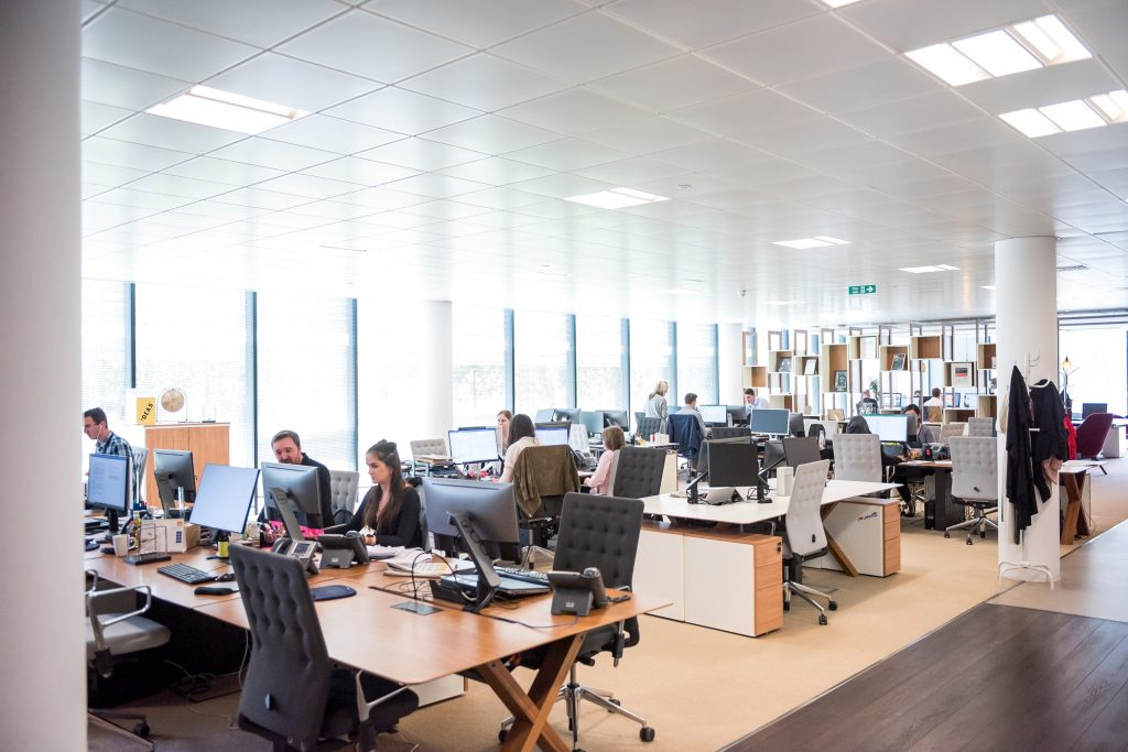 A pre-Covid open office with nobody wearing masks