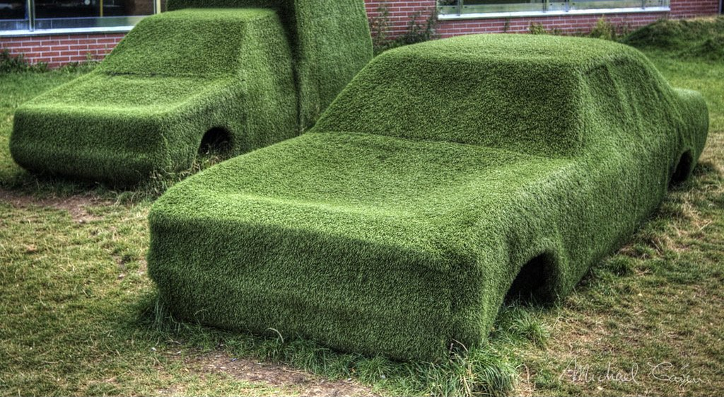 Picture of car and van completely covered with artificial grass