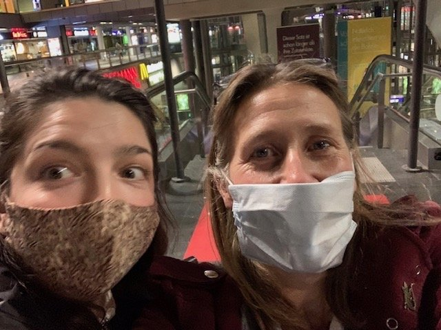 Photo of two women wearing face coverings.