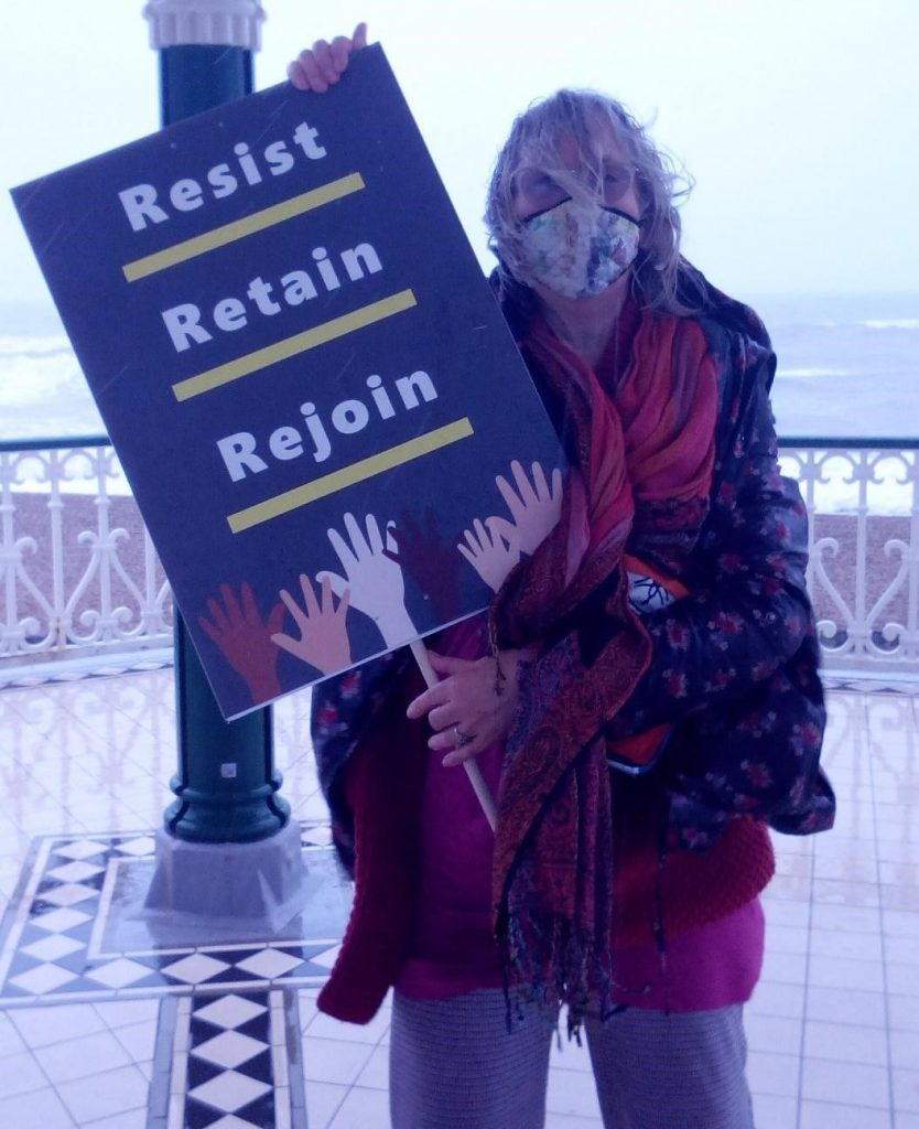 Protester with banner. Photo credit: Amanda Robinson