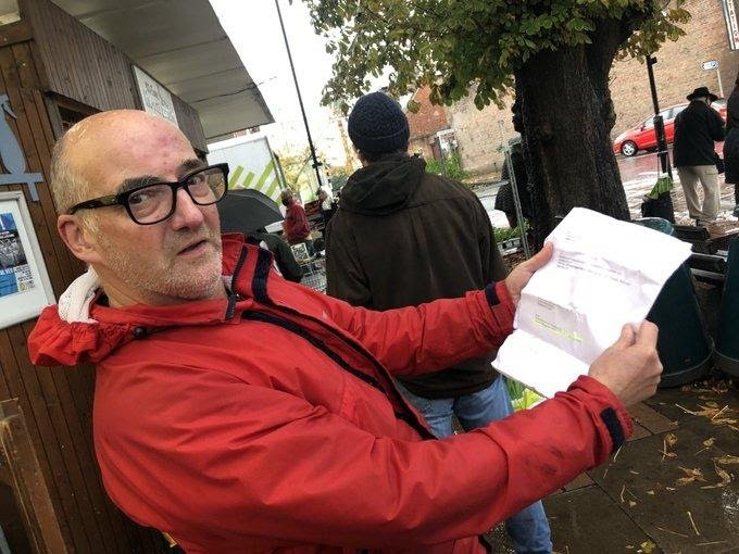Man on a mission: organiser Mark Perryman consulting his rota of volunteers. He believes in keeping the food collections fun. Photo credit: Nigel French