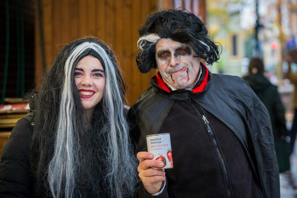 Costumed volunteers Molly and Keith Walker from Kaleidoscope Drama join the growing Lewes community coalition against food poverty for their shift outside Waitrose. Photo credit: Nigel French