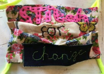 """Picture of a quilting project by Hastings & Rother Buddies with """"Stitch for Change"""" embroidered on it"""
