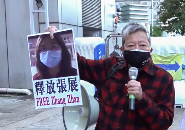 Campaigner holds sign saying FREE Zhang Zhan