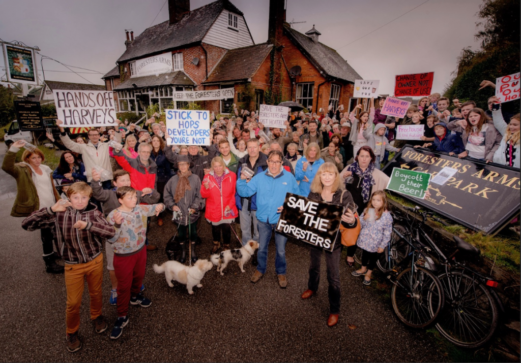 Photo of East Hoathly residents in 2017 campaigning to save their village pub, the Foresters' Arms.