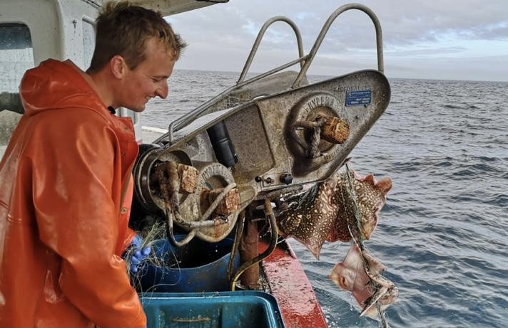 Newhaven fisherman Tom Downey aboard his boat checks on the latest catch.