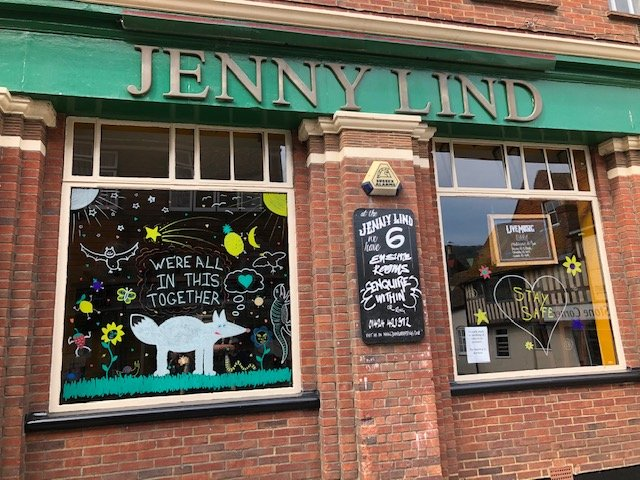The outside of the Jenny Lind pub in Hastings Old Town, photographed during the first lockdown in 2020. A sign on a decorated window says: We're all in this together.