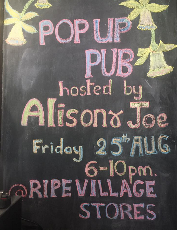 Photo of chalk board advertising a 'Pop-up Pub' evening at the community's village stores in Ripe, East Sussex (the village lost its only pub a few years ago)