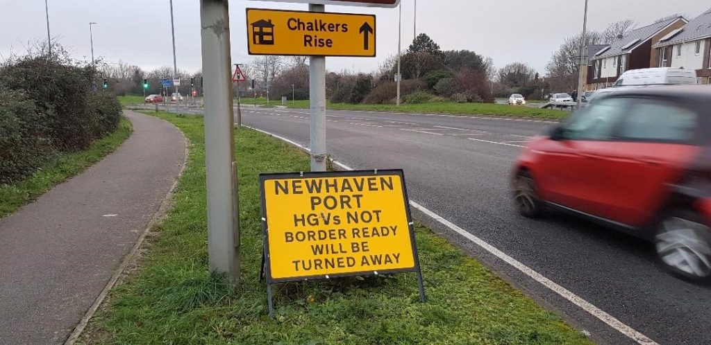 Photograph of a road sign that reads: Newhaven Port - HGVs not border-ready will be turned away.