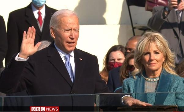 Joe Biden being sworn in, his wife Jill at his side.