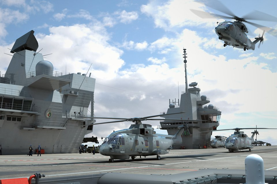 Helicopters landing on a Royal Navy aircraft carrier