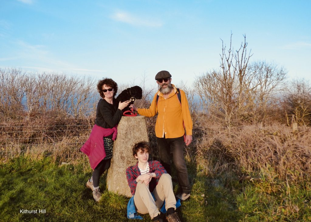 The Joughin family (James, his wife and son plus Ringo the dog) at the Kithurst Hill trig point, South Downs, late Autumn 2020