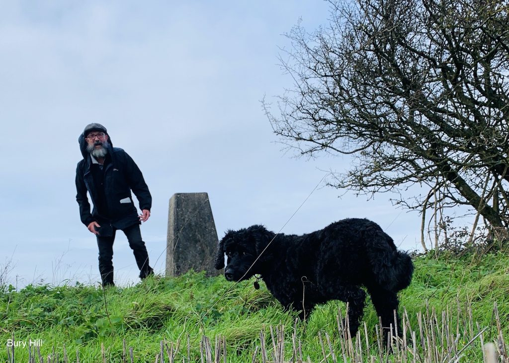 """James Joughin and Ringo the dog reaching what they believed at the time was the """"final"""" trig point at Bury Hill, South Downs, late Autumn 2020"""