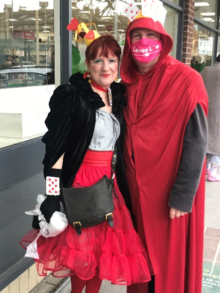 Man and woman dressed as King and Queen of Hearts.