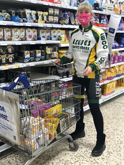 Cyclist loading up a supermarket trolley.
