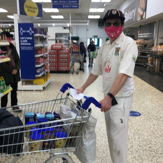 Cricket player shopping in supermarket.