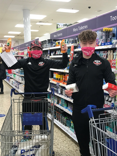 Two young footballers in supermarket.