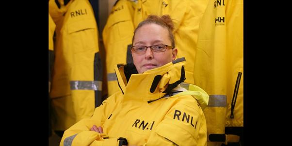 Lifeboat crew member in RNLI gear.