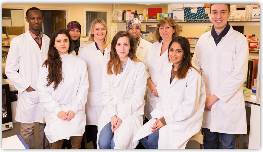 The author Professor Louise Serpell standing with members of her Lab research group at the University of Sussex