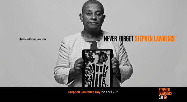 A poster showing Stephen Lawrence's mother, Baroness Doreen Lawrence, holding a picture of her murdered son