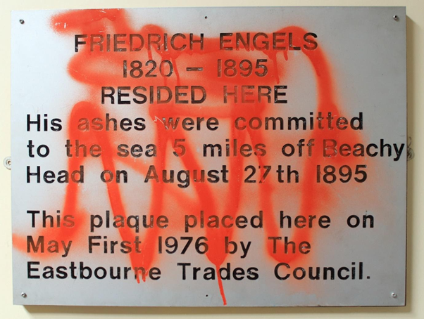 Memorial plaque to Friedrich Engels, with red paint sprayed all over it.