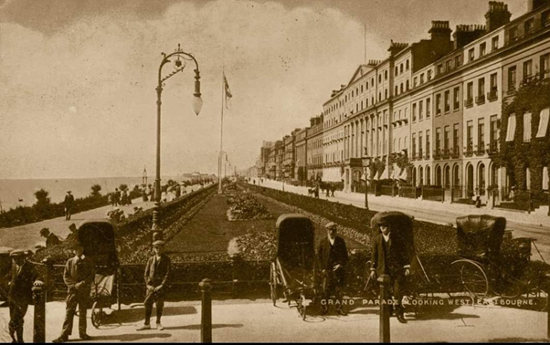 Black and white photo of bath chair men on Eastbourne seafront.