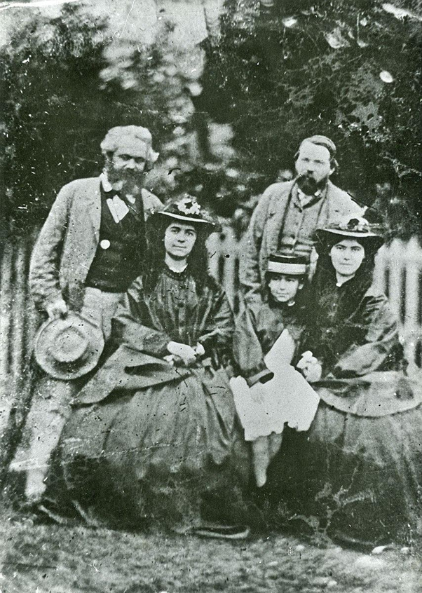 Black and white photo of Karl Marx, Friedrich Engels and Marx's three daughters