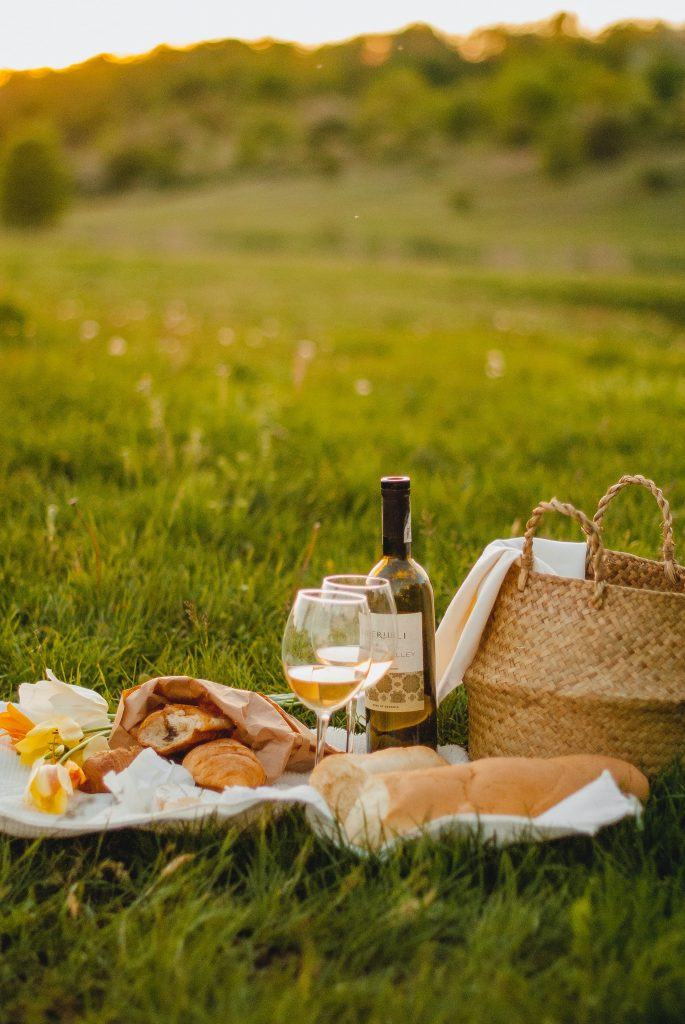 Photo of a country picnic with bread and wine.