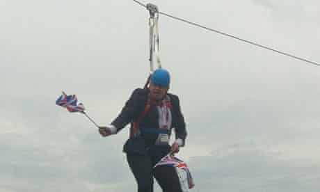 Then-mayor Boris Johnson dangling from a stuck zip wire during his now-famous publicity stunt gone awry promoting the 2012 London Olympics.