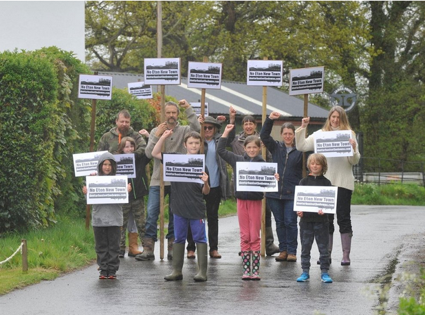 East Chiltington villagers protesting the proposed development of nearby unspoiled countryside that is owned by Eton College