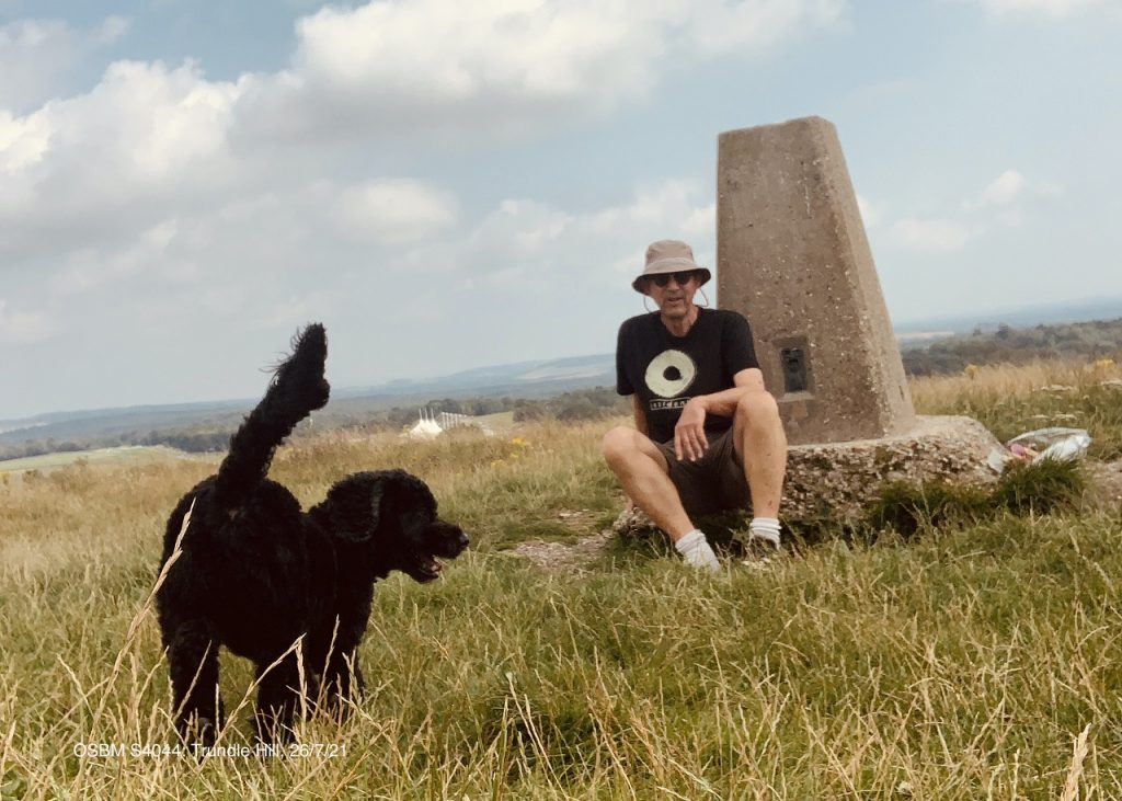 James and Ringo the dog at the Trig Point on Trundle Hill.