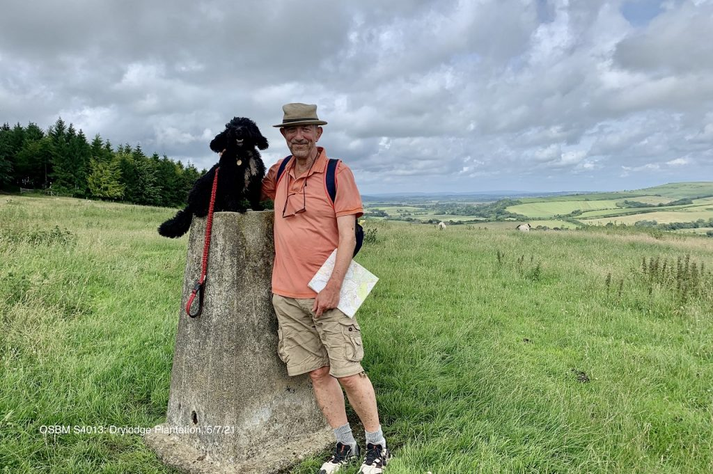 James and Ringo the dog at the Trig Point on Drylodge Plantation.