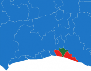 An electoral map of Sussex, entirely Tory blue except for Brighton with two red and one green patch