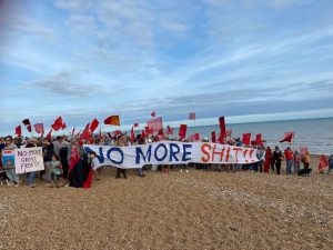 Protesters on a Hastings beach following yet another sewage spill by Southern Water