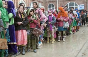 A line of child refugees in Kabul, Afghanistan