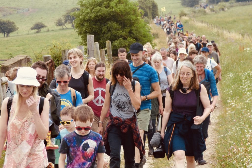 Lots of people walking on the Mass Trespass.