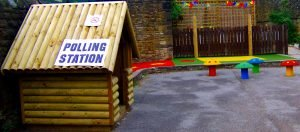 Tiny polling station for pixies in a colourful children's playground