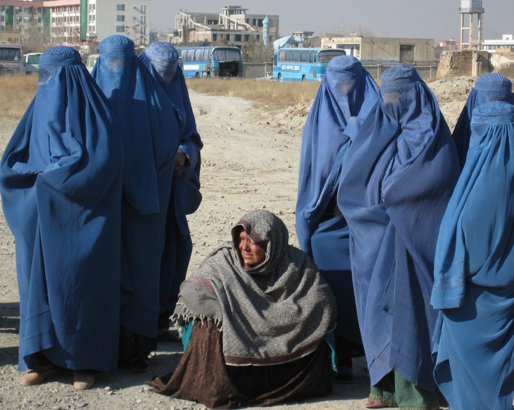 A group of Afghan women covered head to toe in blue burgas
