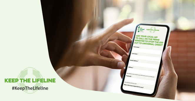 """Woman looking at The Trussell Trust's """"Keep the lifeline"""" petition on her smart phone"""