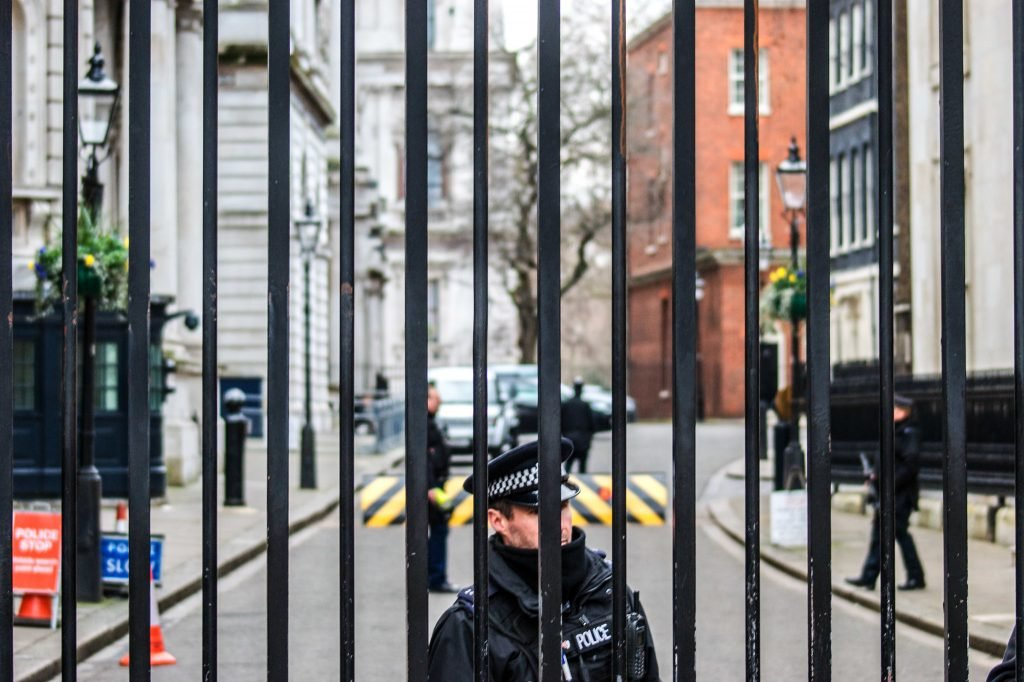 Police on guard at Downing Street seen through the railings
