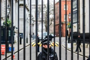 Downing Street police guards seen through the railings