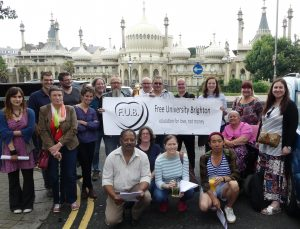 Free University Brighton banners with crowd of people